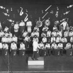 The Jesuit High School Pop Concert Band performance of January 1958, Charles standing with bass drum. The Last Roundup 1958.