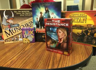 Five Board Games Sitting On a Table